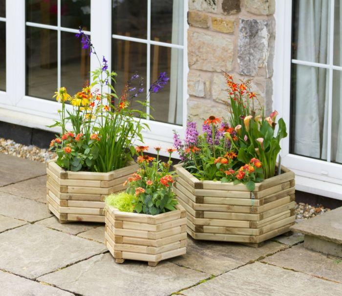 1001 ideas de decoraci n de jard n con maceteros grandes - Palets decoracion jardin ...