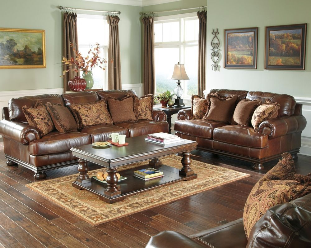 Ashley genuine top grain leather brown sofa loveseat chair and a half set of 3 lodge for Ashley leather living room furniture