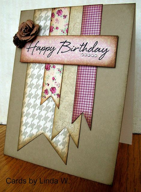 Happy Birthday Card-Hero Art:  ST514 Houndstooth Background  CL574 Say it All  PS624 Earth Layering Papers  CH117 Clear Gemstones    Other:  My Mind's Eye pp - Lost & Found Blush  Prima flowers  Gathered Twigs Distress Ink  Jet Black Archival Ink