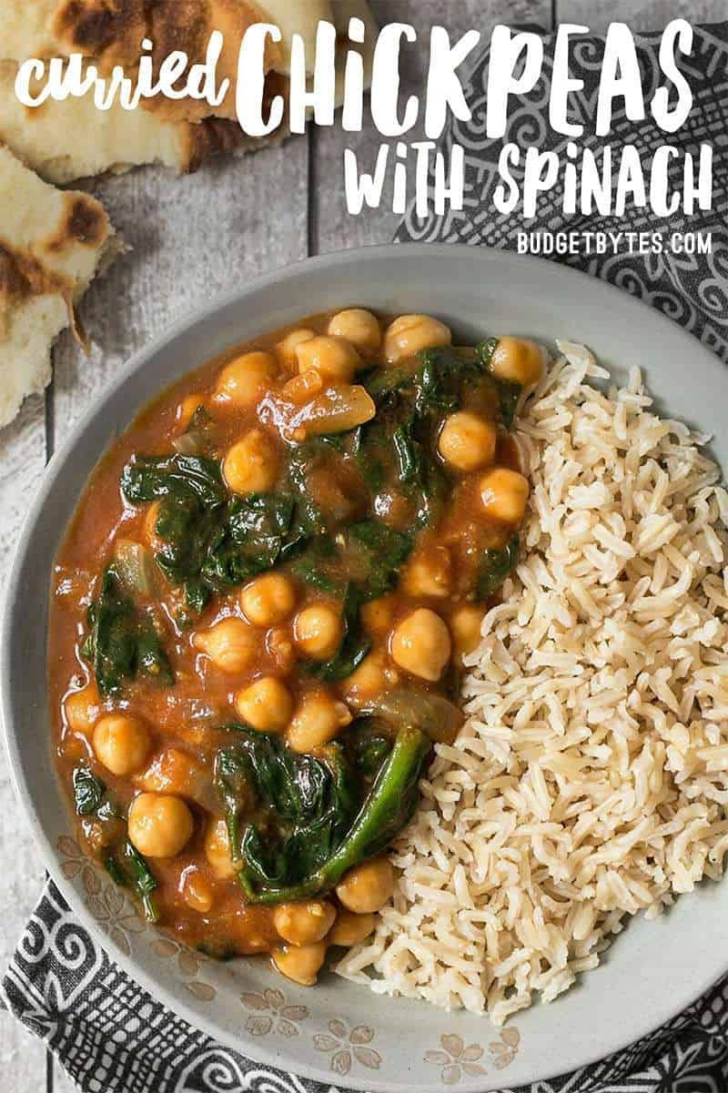 These super fast Curried Chickpeas with spinach are packed with flavor and nutrients, vegan, gluten-free, and filling! Plus they freeze great! Budgetbytes.com #vegan #veganrecipes #veganfood #glutenfree #chickpea #curry #easyrecipe #easydinner #yummy #yummyfood