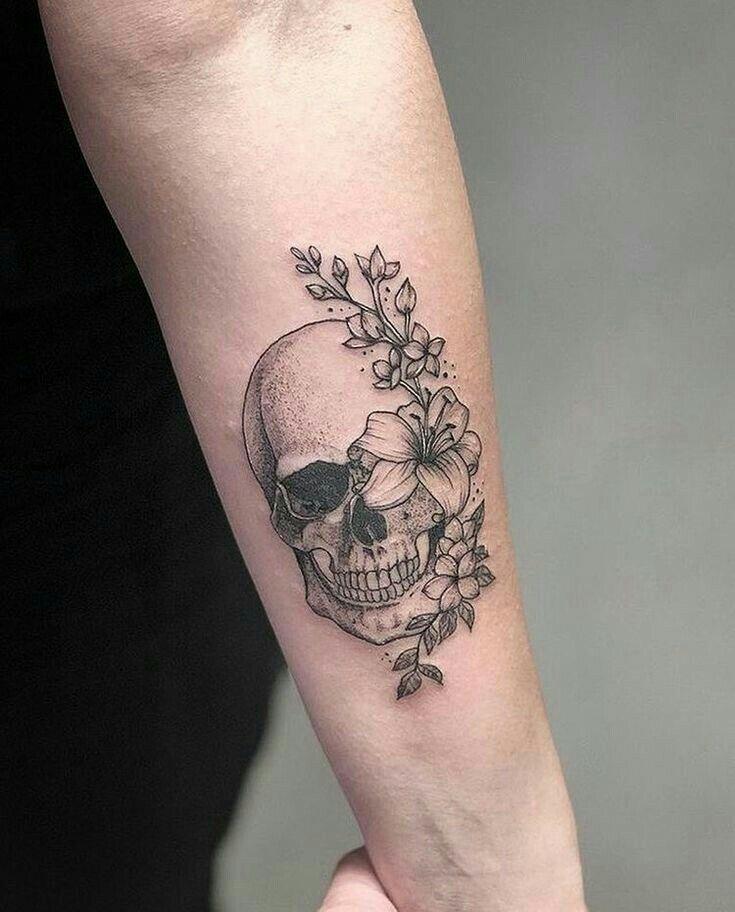 Amazing skull and flowers tattoo