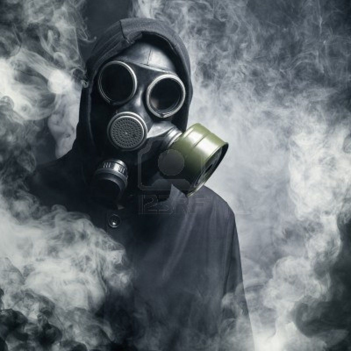 15912466 a man in a gas mask in the smoke black background