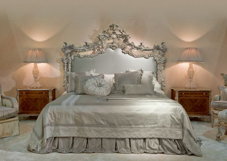 Hand carved rococo bed upholstered in silk.
