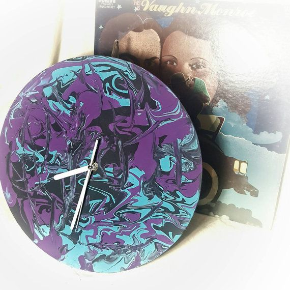 Check out this item in my Etsy shop https://www.etsy.com/listing/491391623/handcrafted-vinyl-record-clock-liquid