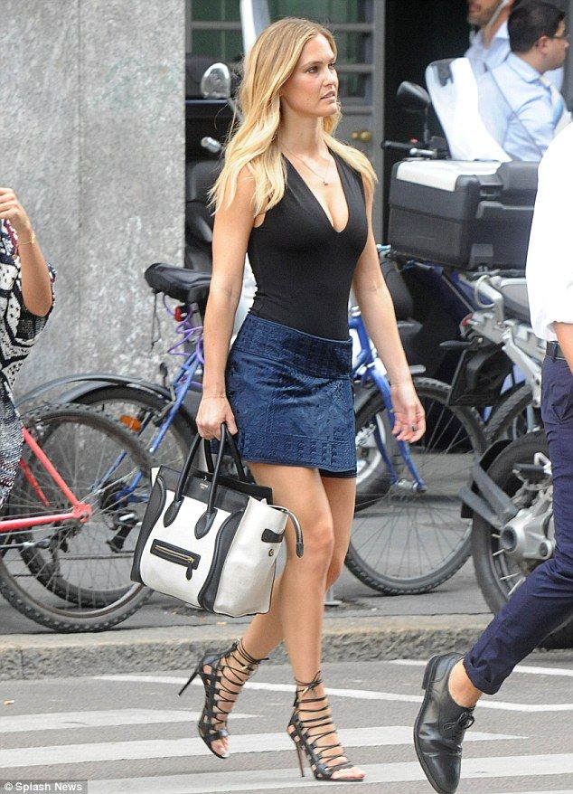 Bar Refaeli looks leggy in a tiny wrap skirt in Milan ...