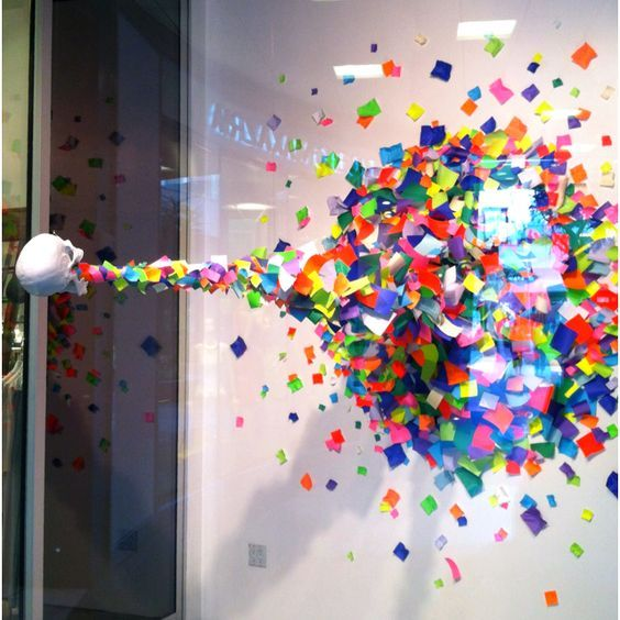 Skull spewing out colored paper squares in the Joe Jeans window in Santa Monica.: