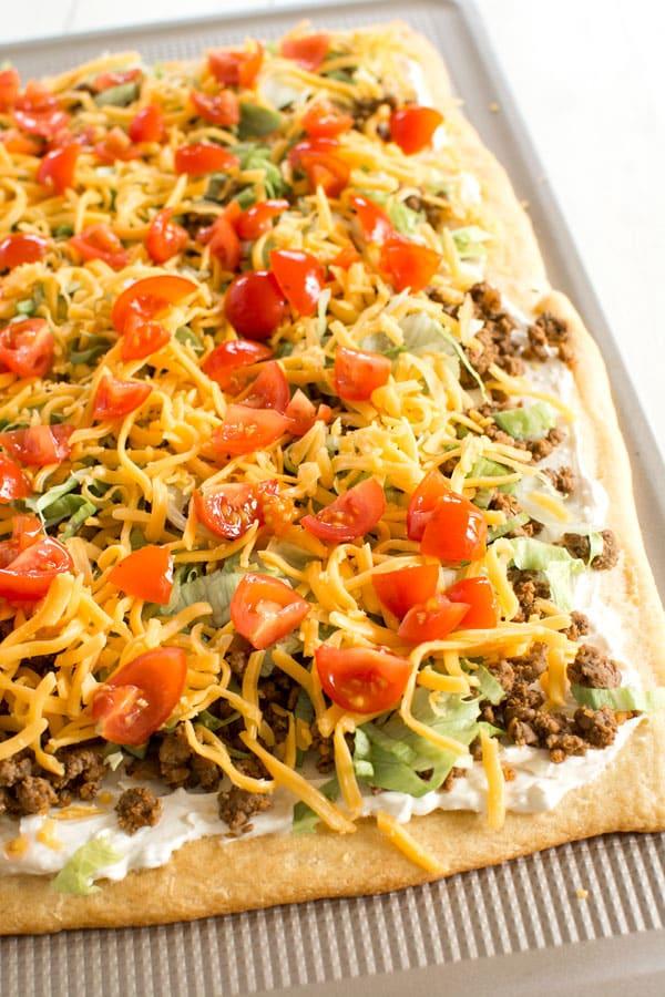 Taco Pizza Appetizer (w/crescent roll crust) | Kitchen Gidget #footballpartyfoodappetizers