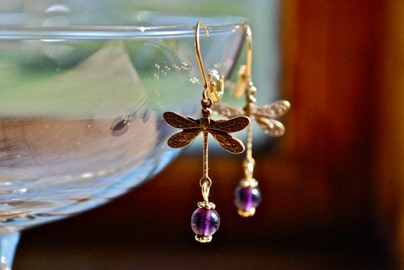 I bought these in black...love them!   http://www.etsy.com/listing/152658008/antique-bronze-dragonfly-earrings-a