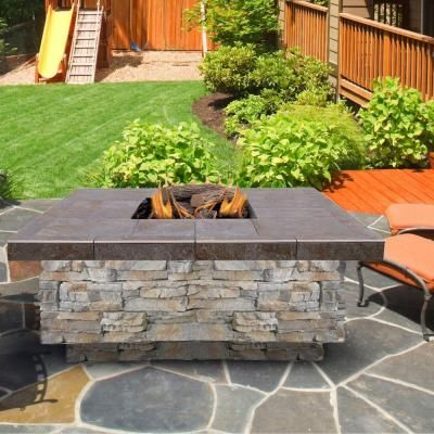 cal flame 48 in gray natural stone propane gas fire pit with log set and lava rocks fpt s301 ns. Black Bedroom Furniture Sets. Home Design Ideas