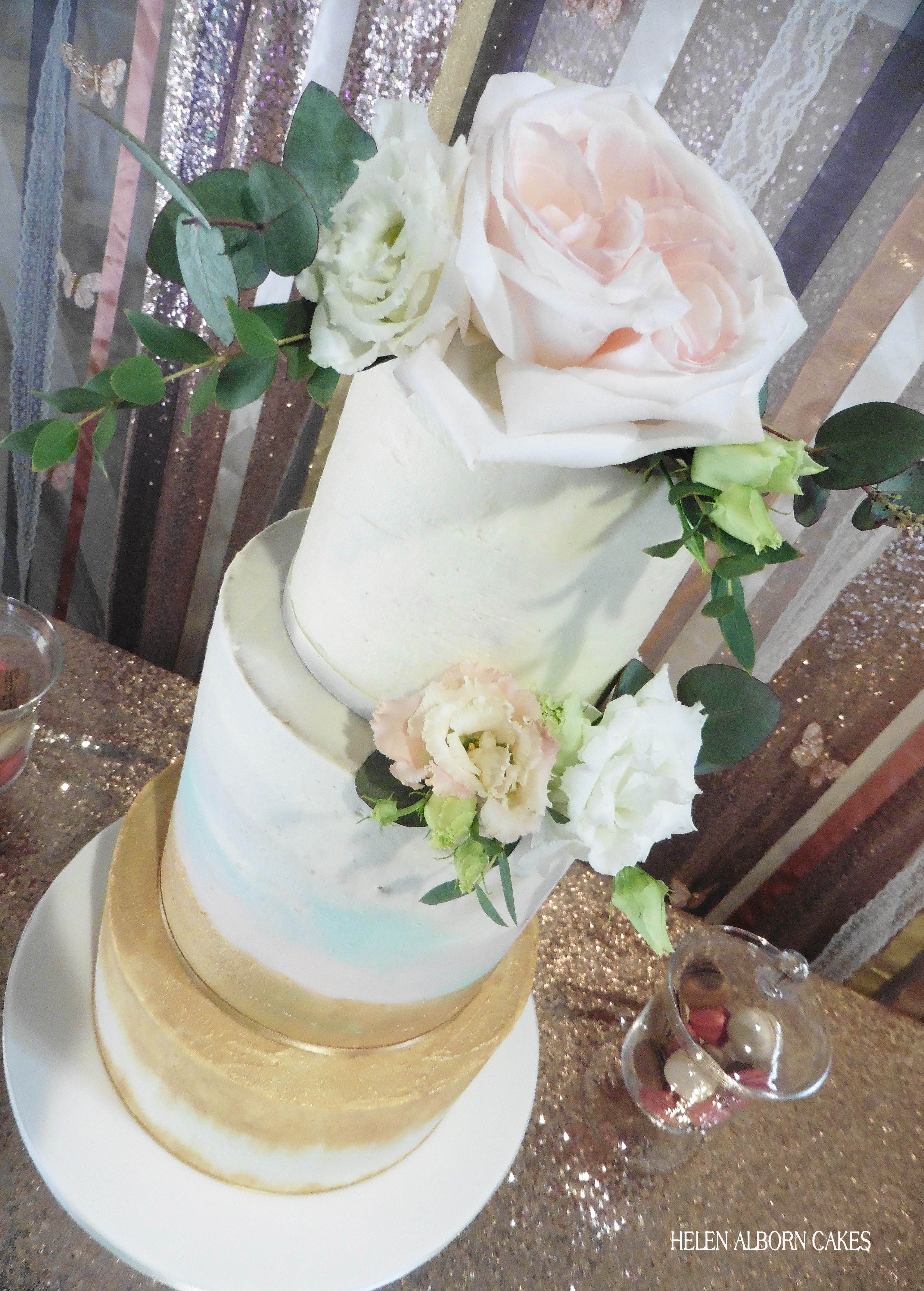 Tall tiered wedding cake in buttercream with watercolour effect ...