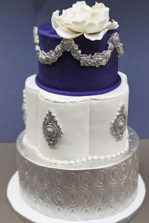 Glamorous silver, white and royal blue wedding cake; Featured Cake: Alliance Bakery