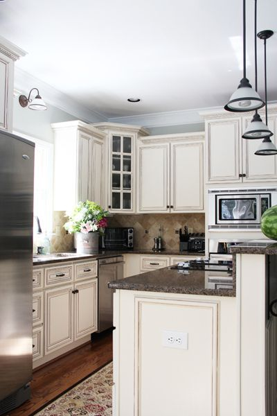 Bright kitchen with cream colored cabinet and Restoration Hardware ...