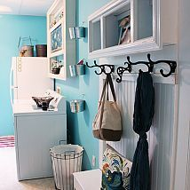 Nice cubbies and hooks.  Happy Aqua Blue Laundry Room Makeover