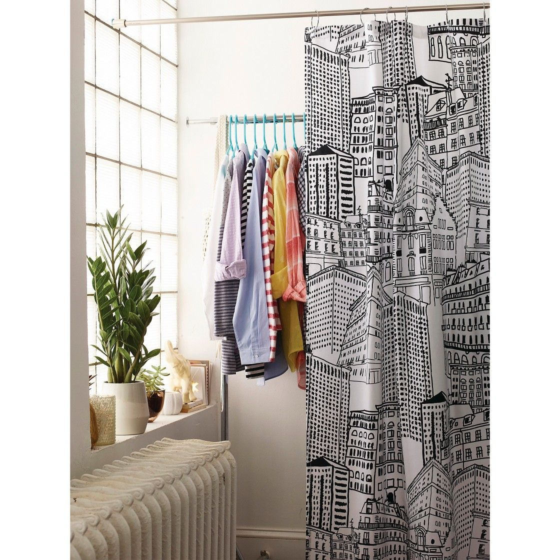 Shower curtain from Target being used as a room divider