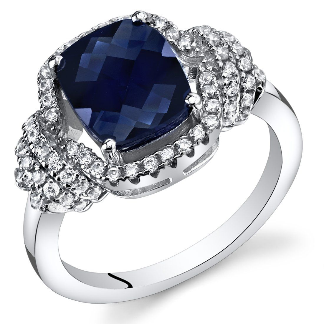 Main StoneLab Created Blue Sapphire2.75 caratsCushion Cut9x7mmCeylon Blue HueEye CleanAccent Stone(s)Cubic ZirconiaRound Brilliant CutPremium GradeMetalSterling Silver925 stamp3.9 gramsRing features exceptional Design, Craftsmanship and Finish. Blue Sapphire is the Birthstone of September. Perfect gift for Mothers Day, Birthdays, Valentines Day, Graduation, Christmas or just about any other occasion. Style SR11414