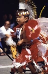 Honoring their heritage and customs, Native Americans of all ages celebrate in Oklahoma City by participating in the Red Earth Parade and Red Earth Festival each June.