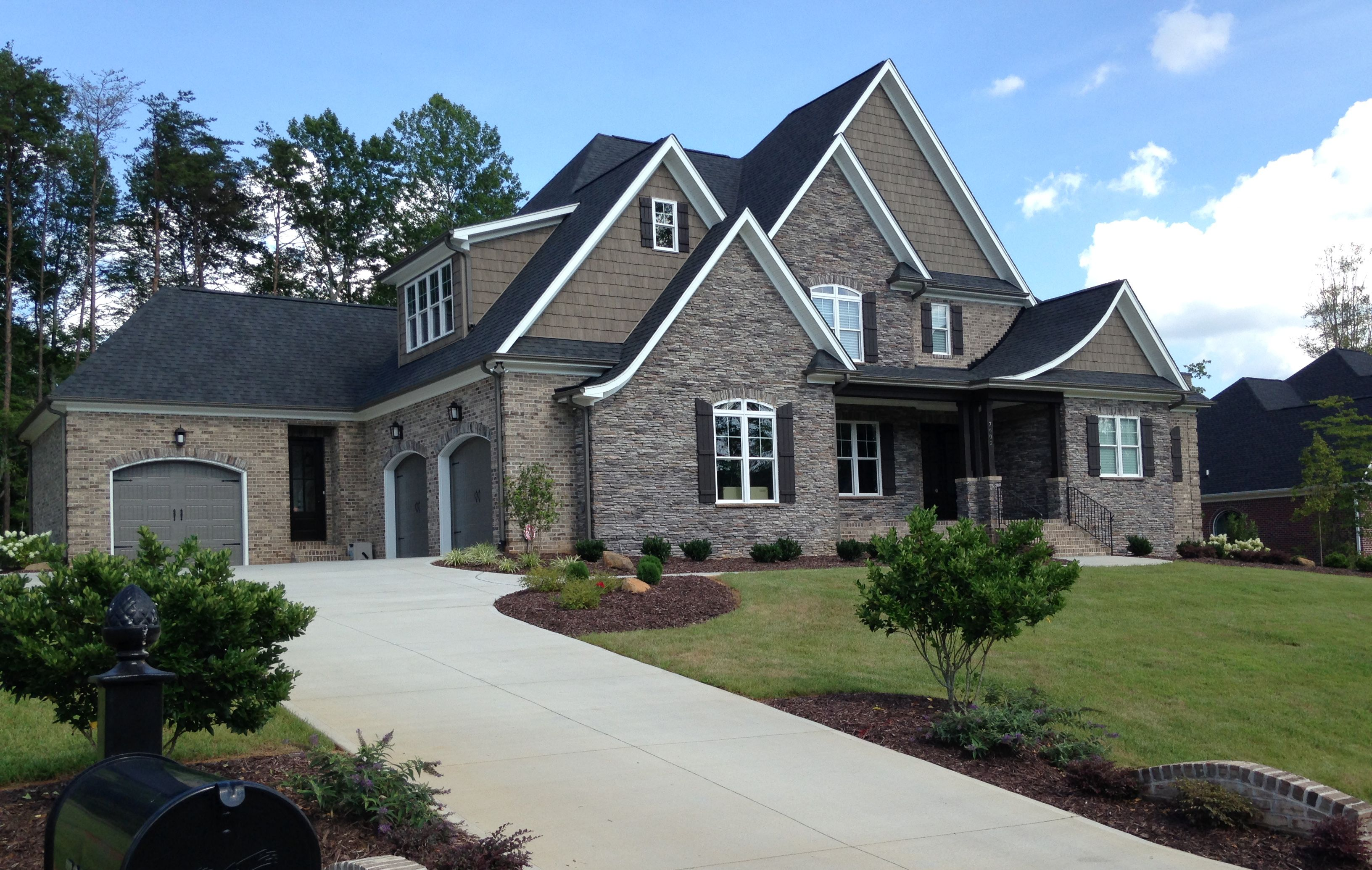 Exterior Design Scheme An Overall Cool Taupe Effect Is Created On This Exterior Using A T Exterior Brick Shutters Exterior Exterior House Colors Combinations