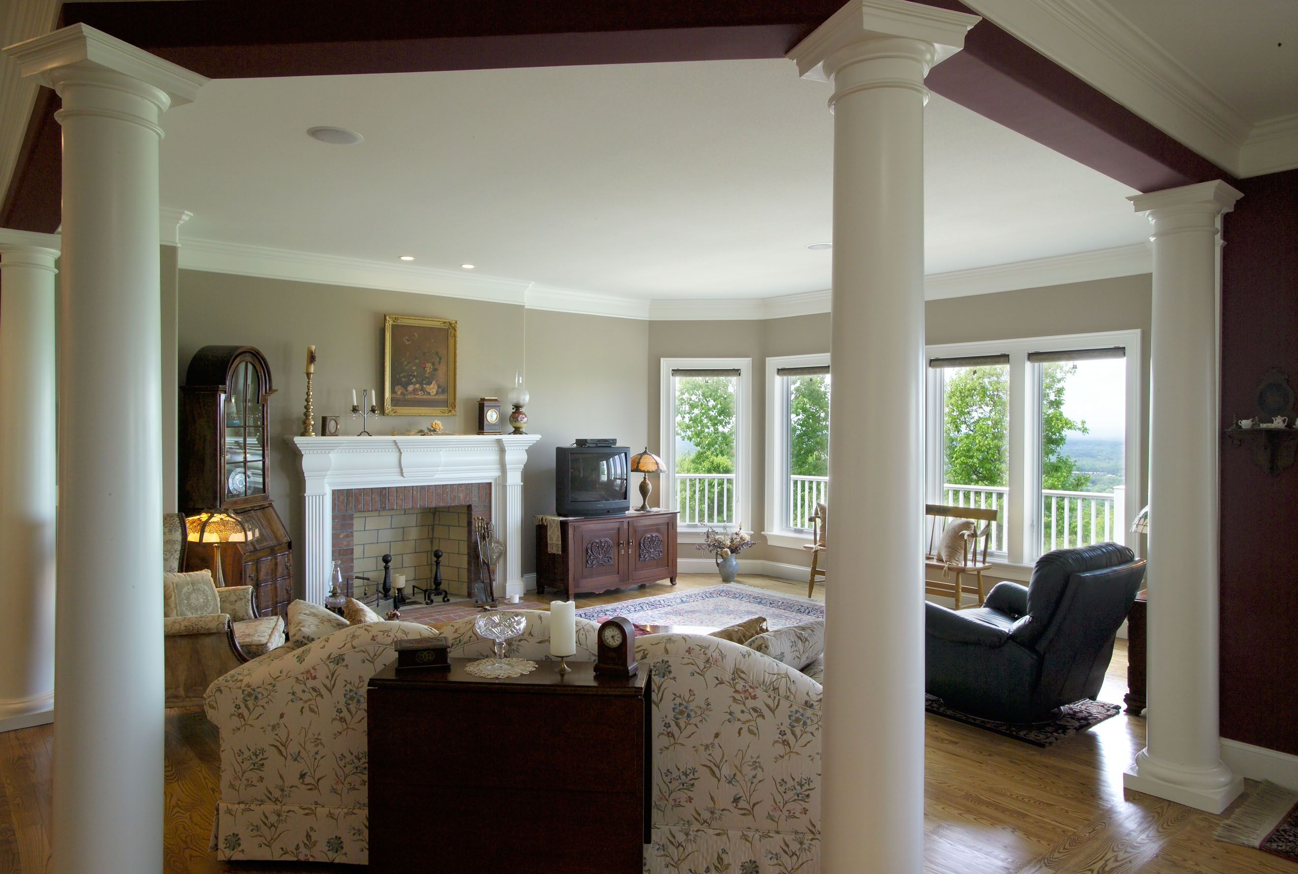 The Columns In This Living Room Separate The Space From The Kitchen But Still Offer The Ease Of An Open Floor Plan Separating Rooms Family Room Open Floor Plan #separate #kitchen #from #living #room #ideas