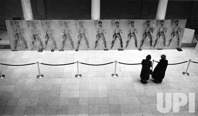 "An Andy Warhol work that had never been displayed in public before, underwent preparations in the Carnegie Museum to be displayed in Pittsburgh on January 22, 1990. The thirtysix foot long work ""Elvis (Eleven Times)"" had sat untouched for decades in Warhol's workshop until his 1987 death."