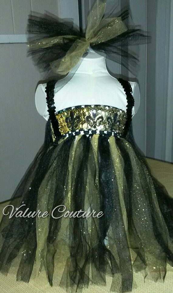 Check out this item in my Etsy shop https://www.etsy.com/listing/227345390/new-orleans-saints-inspired-tutu-tunic
