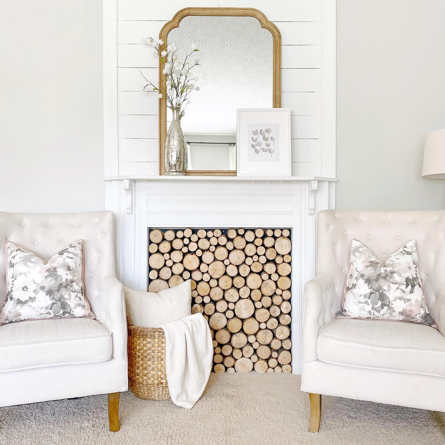 """I've been trying to make a really bold print """"work"""" on the fireplace for more than a week, and it's still not happening. 🤷🏼♀️ So, here's a neutral look more in my comfort zone... 😬🙈 #mytradhome #springdecor #springhomedecor #fauxfireplace #currentdesignsituation #myhomevibe #neutraldecor #neutralhome"""