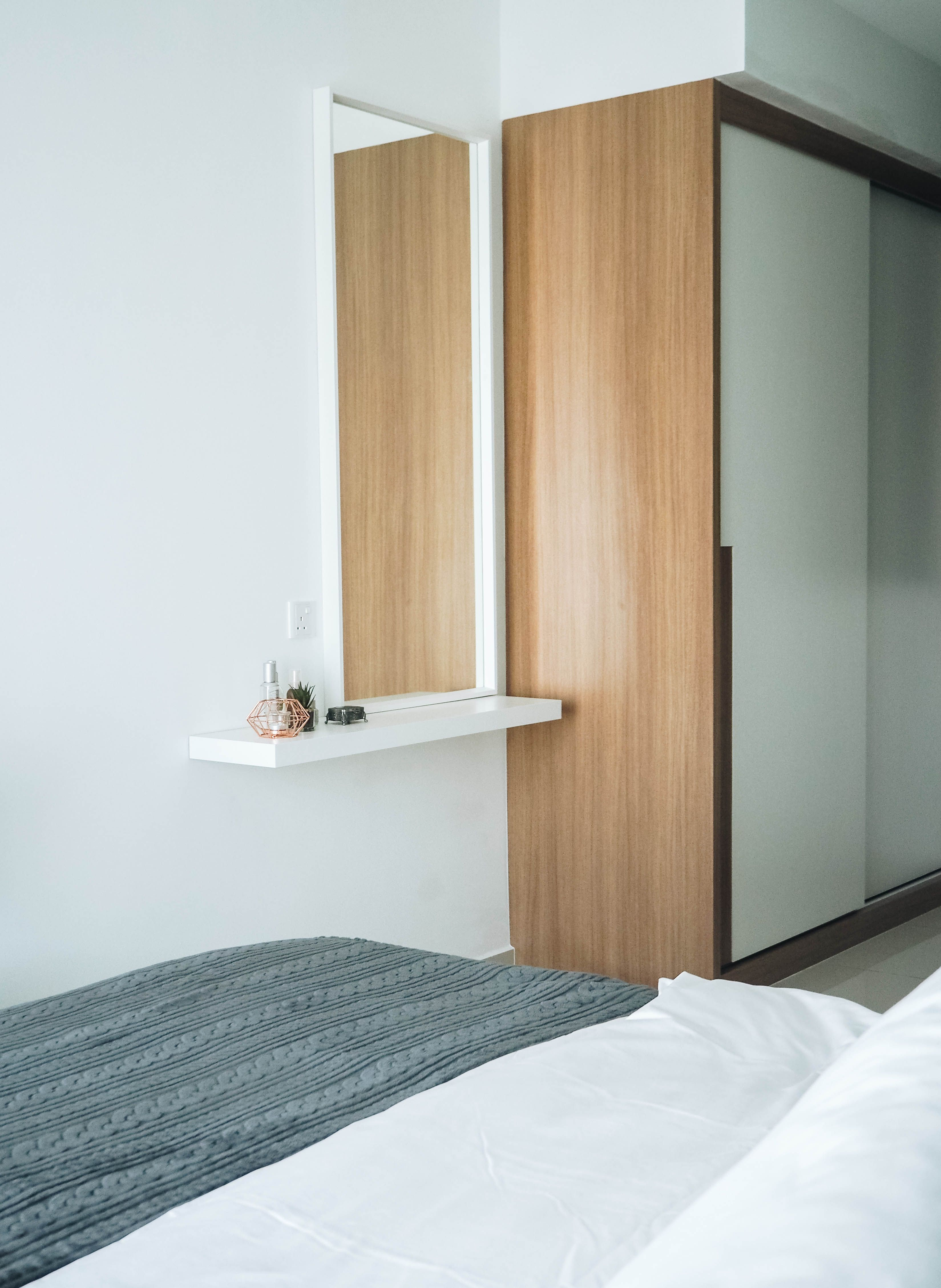 Master bedroom wardrobe with creamy white neutrals oak textures for the furniture pieces specially picked and curated to make the space looks uniformly
