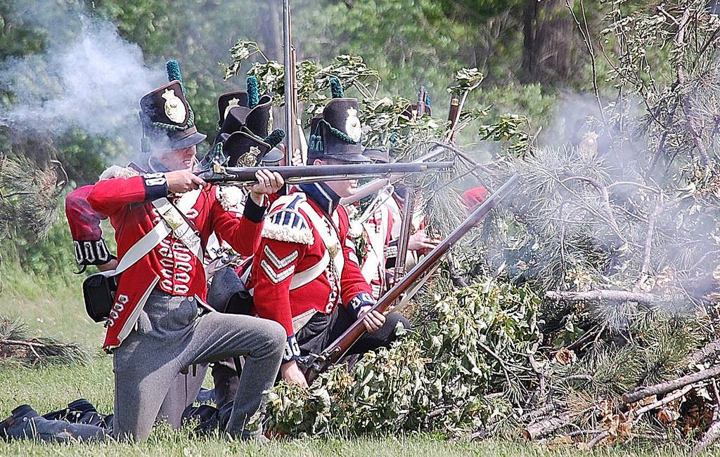 British soldiers firing from a cover of brush. Stoney Creek June '08.