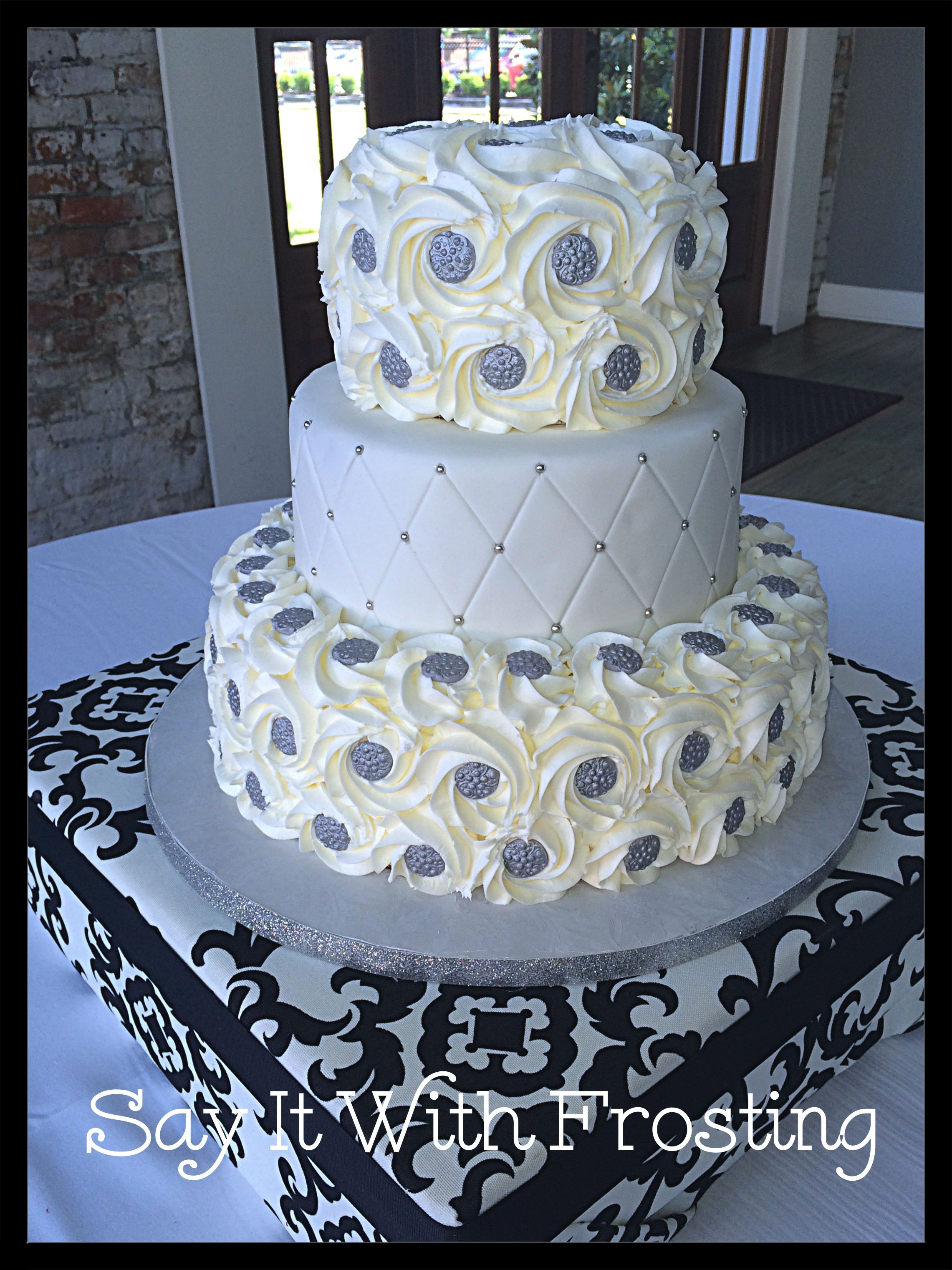 Pensacola Wedding Cakes Custom Cake With Buttercream Rosettes And Modeling Chocolate Medallions Made