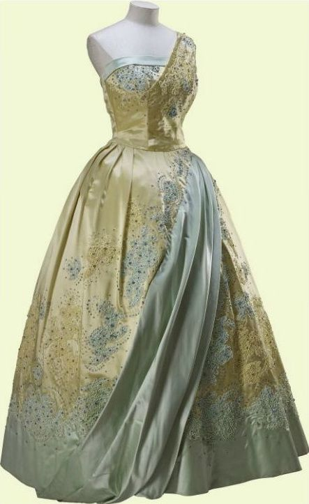 6b1bdc33 Evening Gown, Norman Hartnell: 1958, satin, lace, embroidered with ...