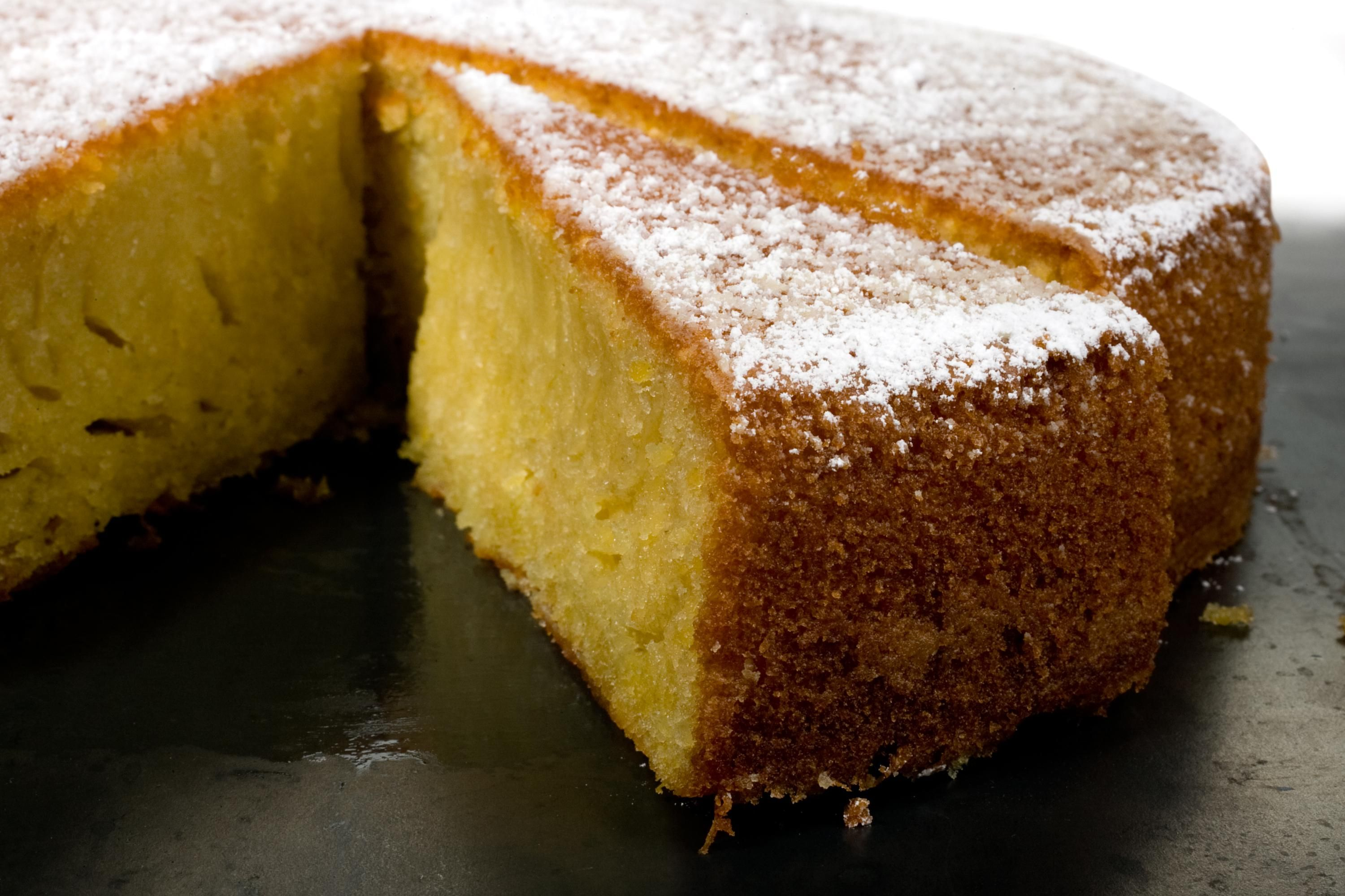 Polenta cake has a hint of orange and a slightly crunchy texture from cornmeal, is moist without being greasy, and is strongly flavored with olive oil... #oliveoilcake