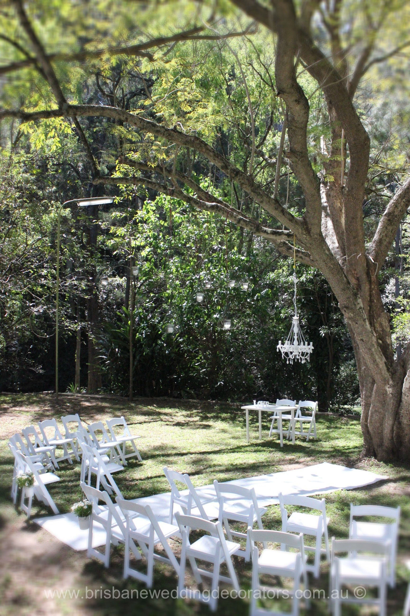 A Brisbane Wedding Decorators Styled White Ceremony Set In Brisbanes Bundaleer Rainforest Gardens With
