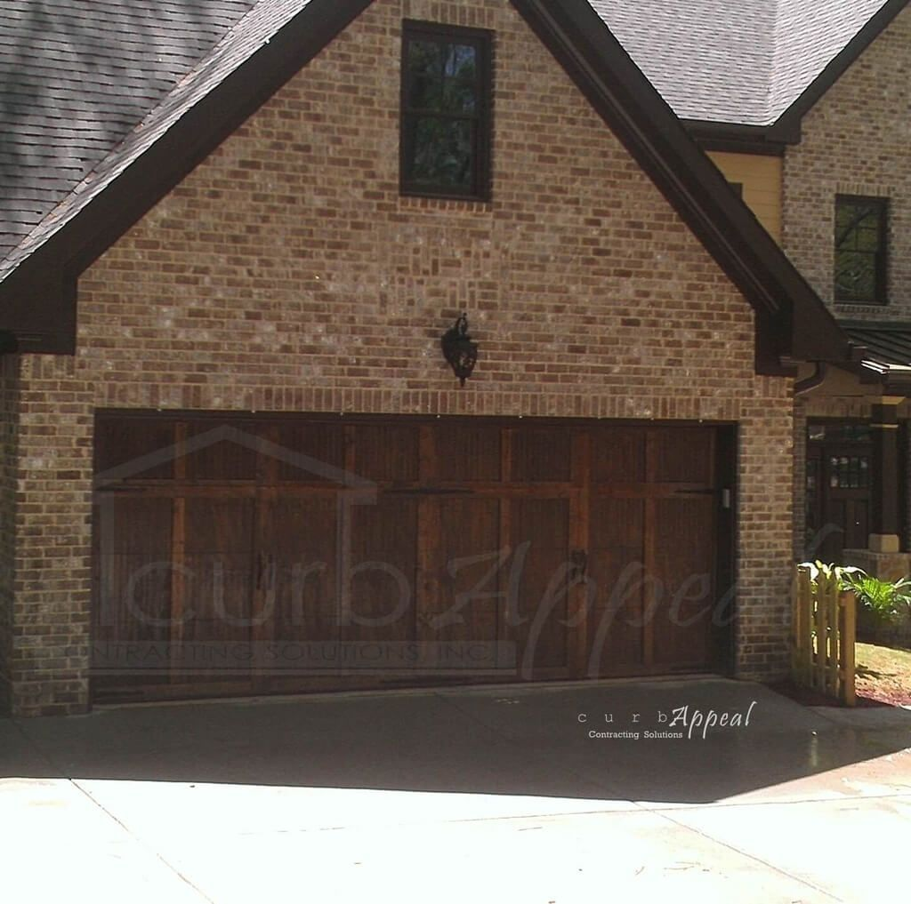 Decorating: Side Hinged Wooden Garage Doors Combined With Brick Walls