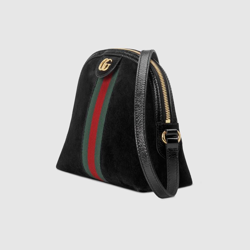47415b760c5b Ophidia small shoulder bag by Gucci. Crafted in black suede with inlaid  green and red Web stripe, this Ophidia shoulder bag has a domed shape that  recalls ...