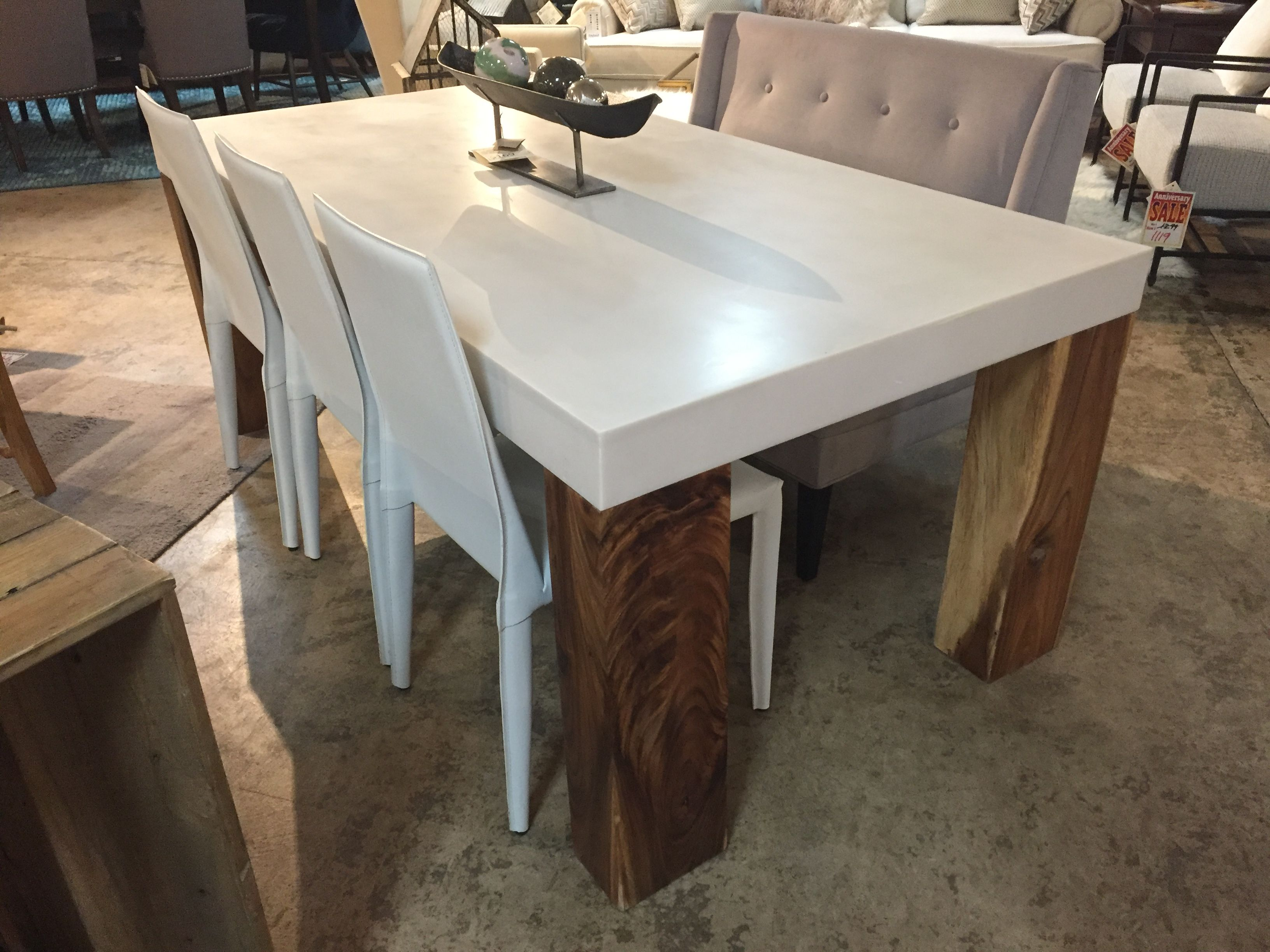 Modern rustic dining room table  A modern rustic dining table smooth concrete top with solid block