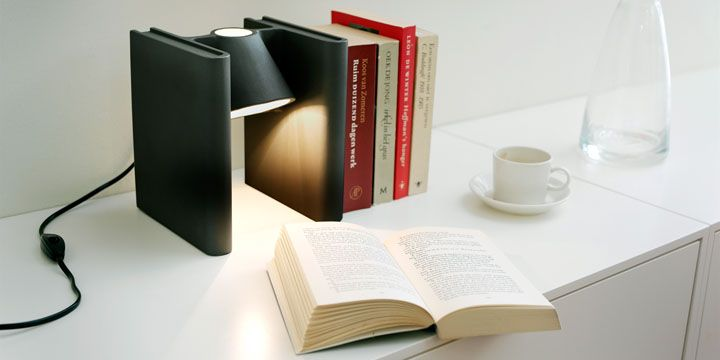 Books shaped bookends connected with a light the idea came to designer roderick vos as he was looking at his library thinking a small light would showcase