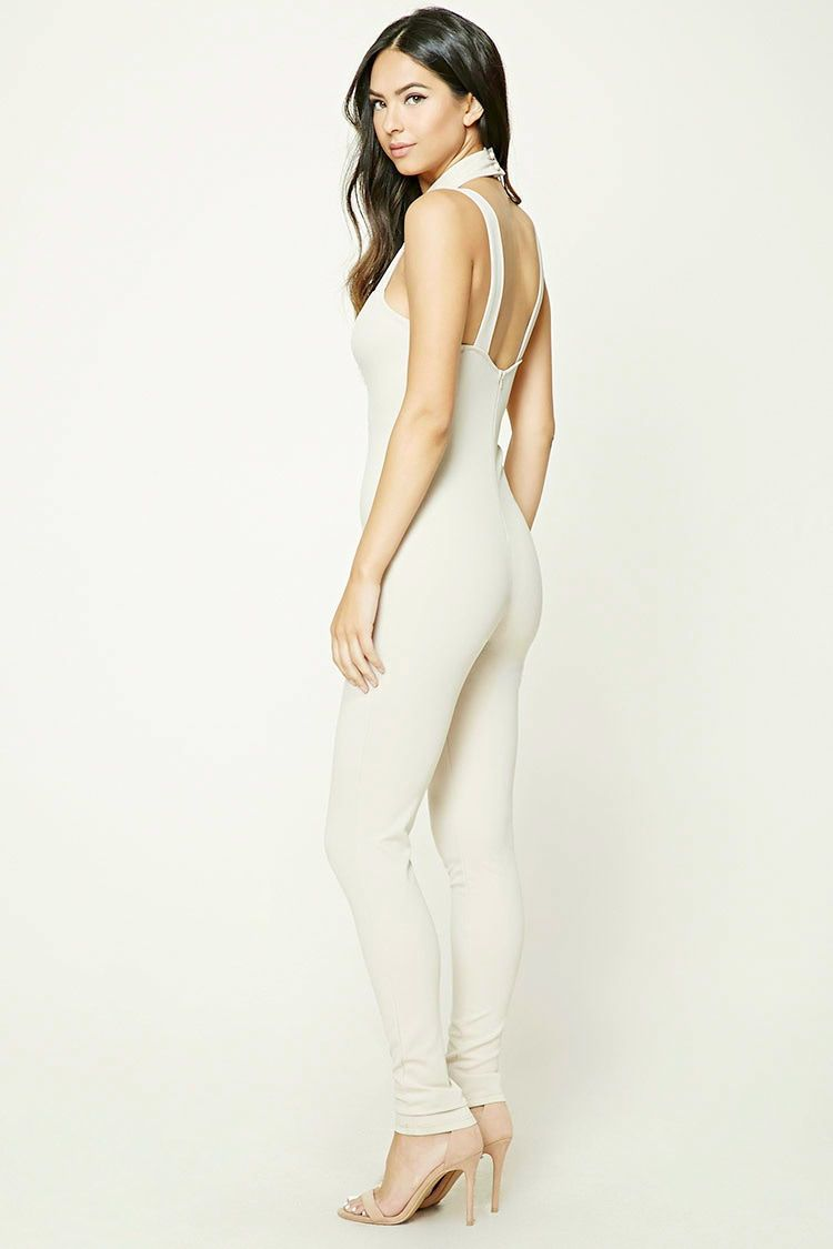 A sleeveless stretch-knit jumpsuit featuring a strappy choker design, sweetheart neckline, and a concealed back zipper.