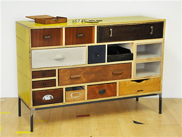 A cabinet of reclaimed drawers from Blanchard's first collection of Margate cabinets. The striking yellow ply reclaimed from the London Olympic  construction site. created by: Rupert Blanchard origin: UK