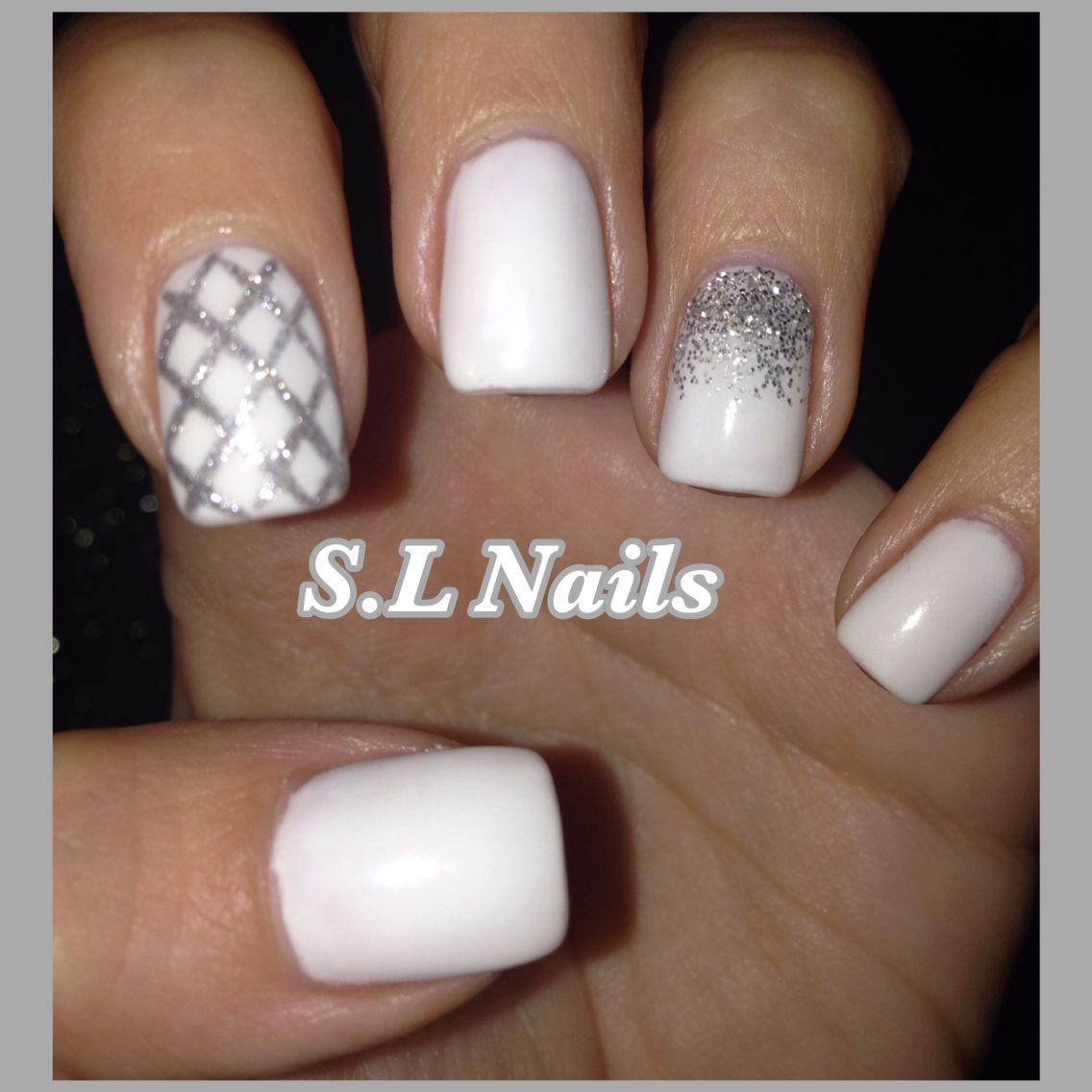 White nail polish with ombre glitter accent and silver glitter ...