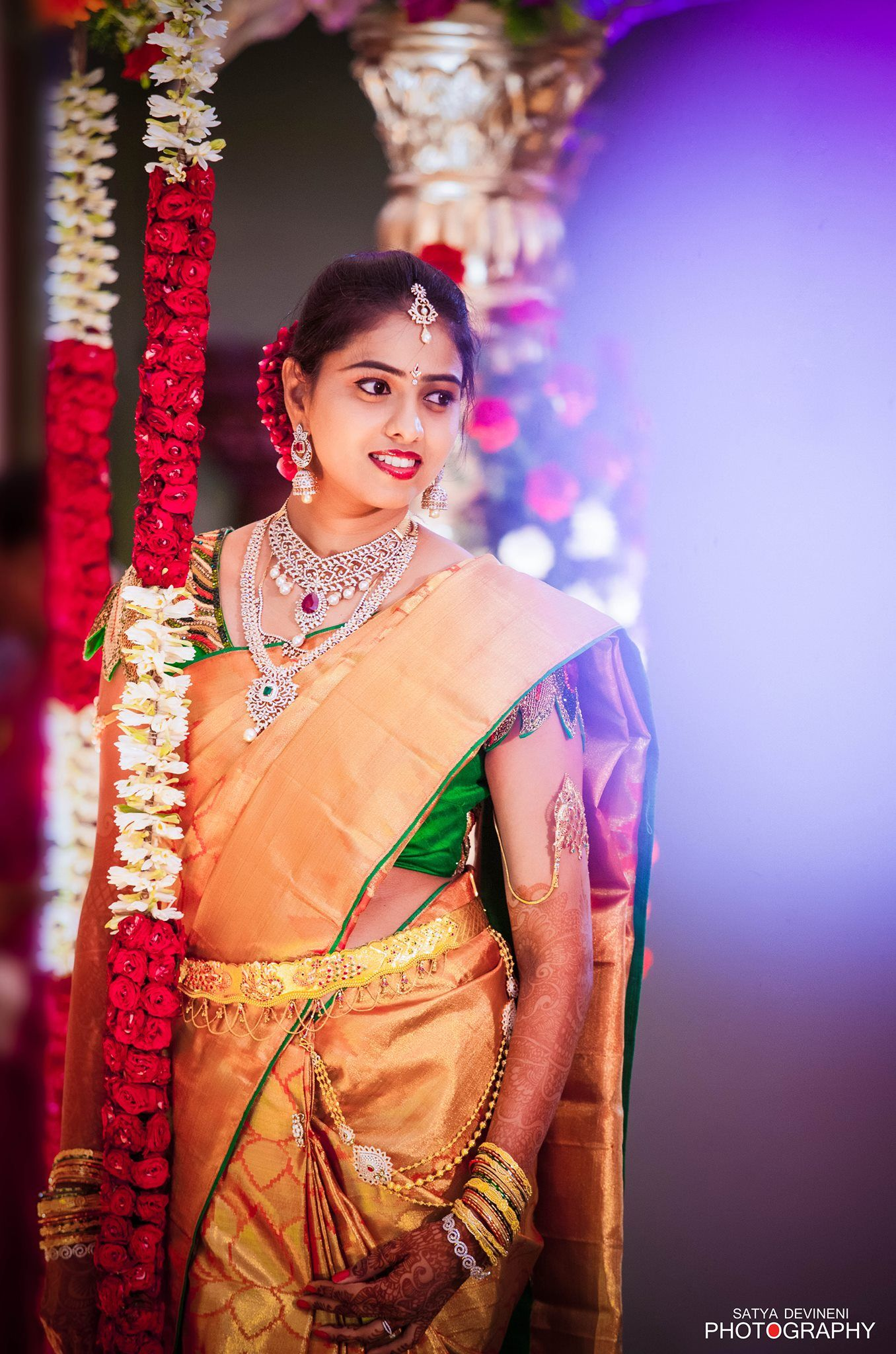 Traditional South Indian bride wearing bridal saree jewellery and