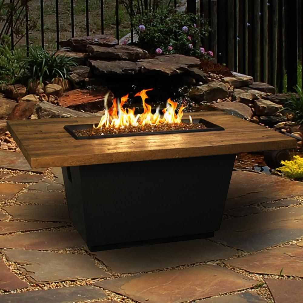 Cosmopolitan 54 inch french barrel oak natural gas rectangular fire table by american fyre designs black lava available at bbq guys