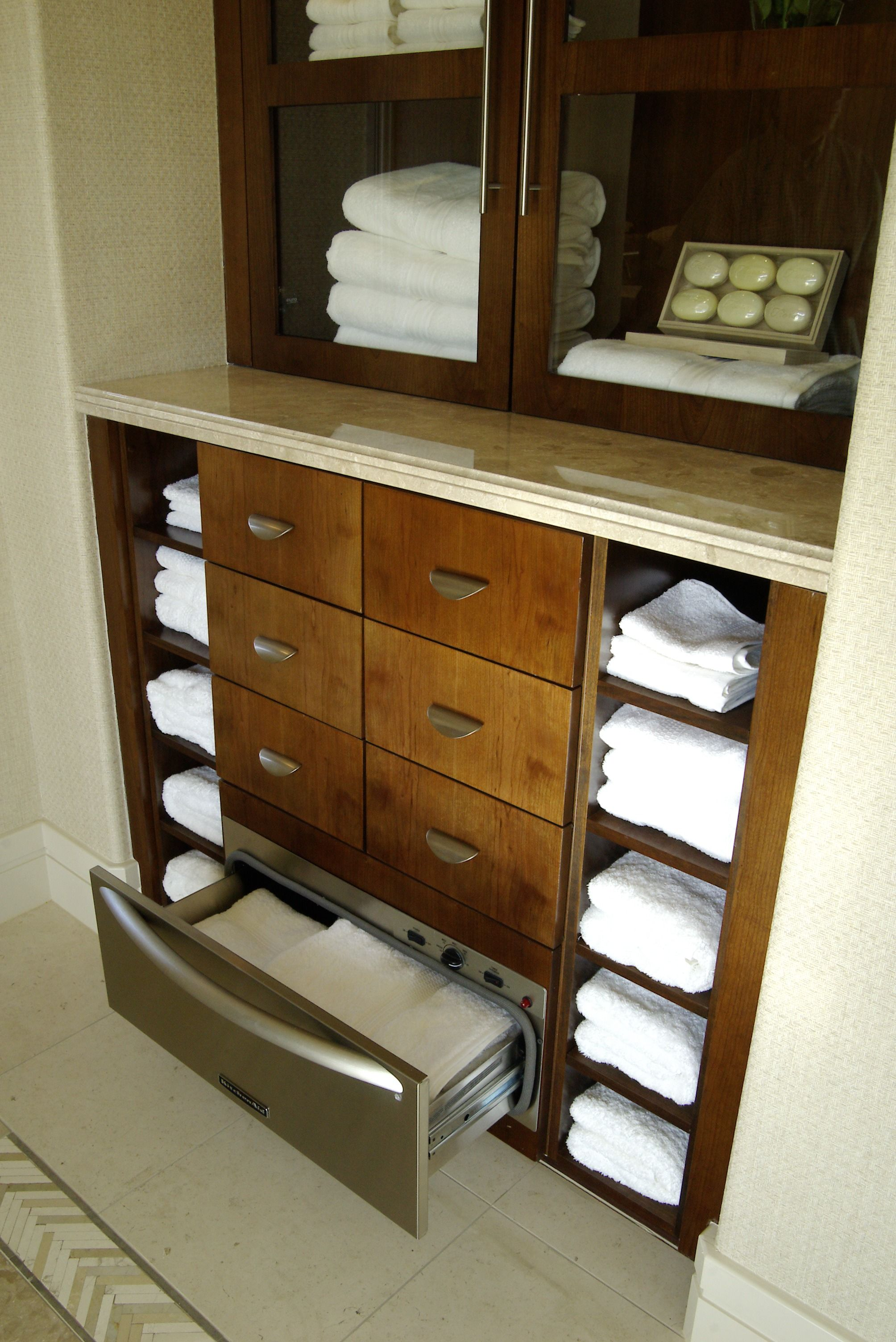 Good Storage Is A Must When It Comes To Master Baths And This One Certainly Has It With Multiple Open Shelves And Towel Warmer Drawer Loft Decor Warming Drawer