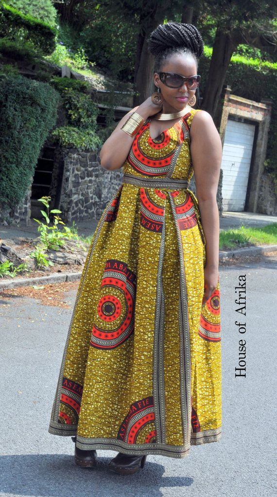 b4112aba97 African print fit and flare maxi dress in brown, mustard, red and cream  hues. It has a full skirt with box pleats and side pockets.