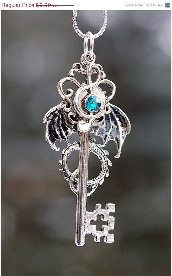 Hey, I found this really awesome Etsy listing at https://www.etsy.com/listing/181519402/sale-dragon-music-key-necklace