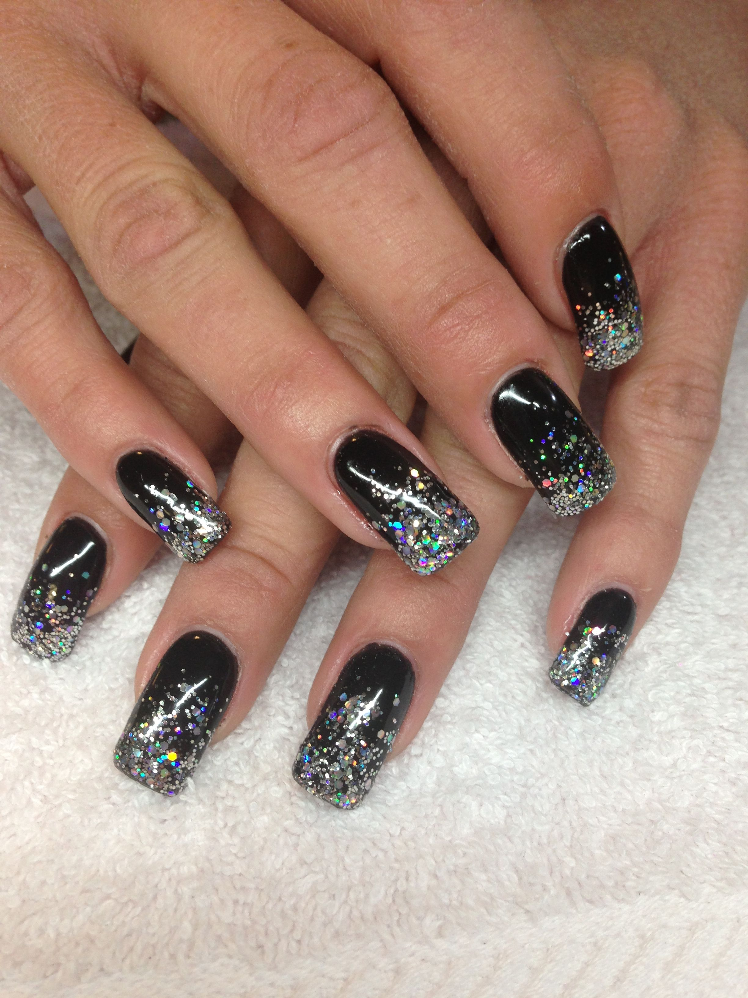 Black and silver nails Black nails with glitter