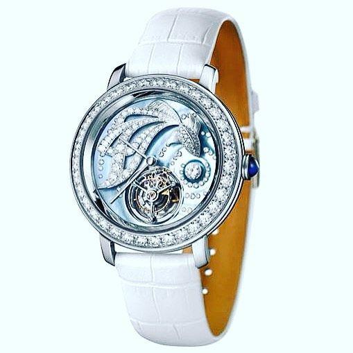 Women love diamonds. And vice versa. The perfect watch for a sparkling Christmas present: the Boucheron Ama Epure Tourbillon @boucheron #boucheron #ama #epure #tourbillon #watch #watchlover #watchaddict #diamond #instawatch #fish #motherofpearl #xmasgift #xmas #luxury #luxe by worldtempus