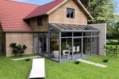 Haus mit Wintergarten und Obergeschoss-Ausbau