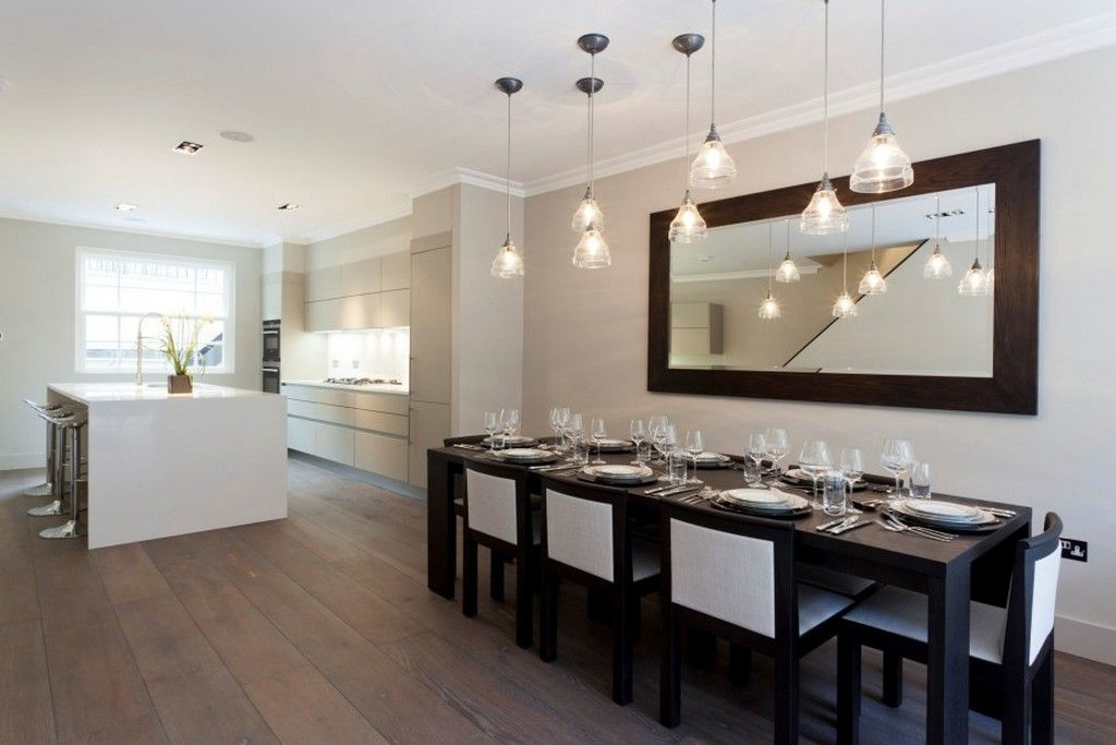 Image result for white glass pendant lights over dining table