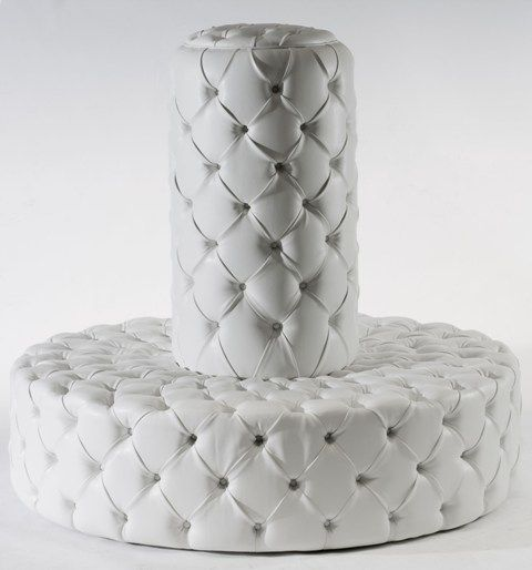 Circular banquette in white leather with button upholstery