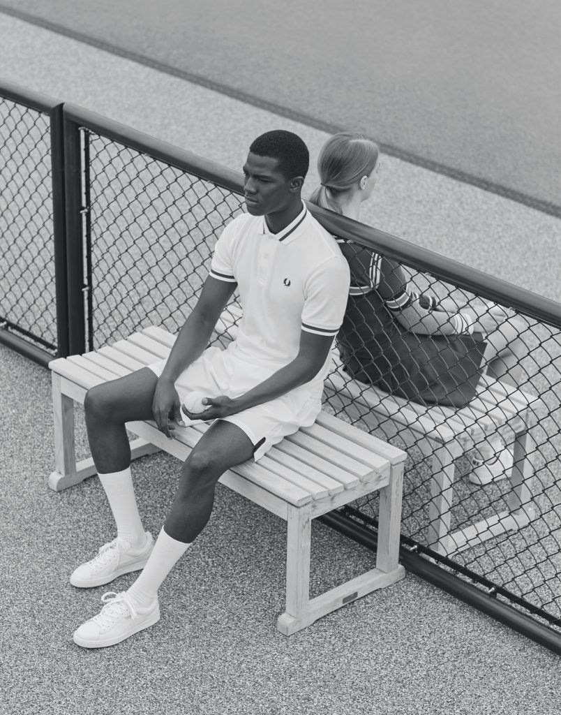 His polo by Fred Perry; shorts by Nike; sneakers by Puma; socks are stylist's own. Her sweater by Acne Studios; skirt by American Apparel; sneakers by Nike; socks are stylist's own