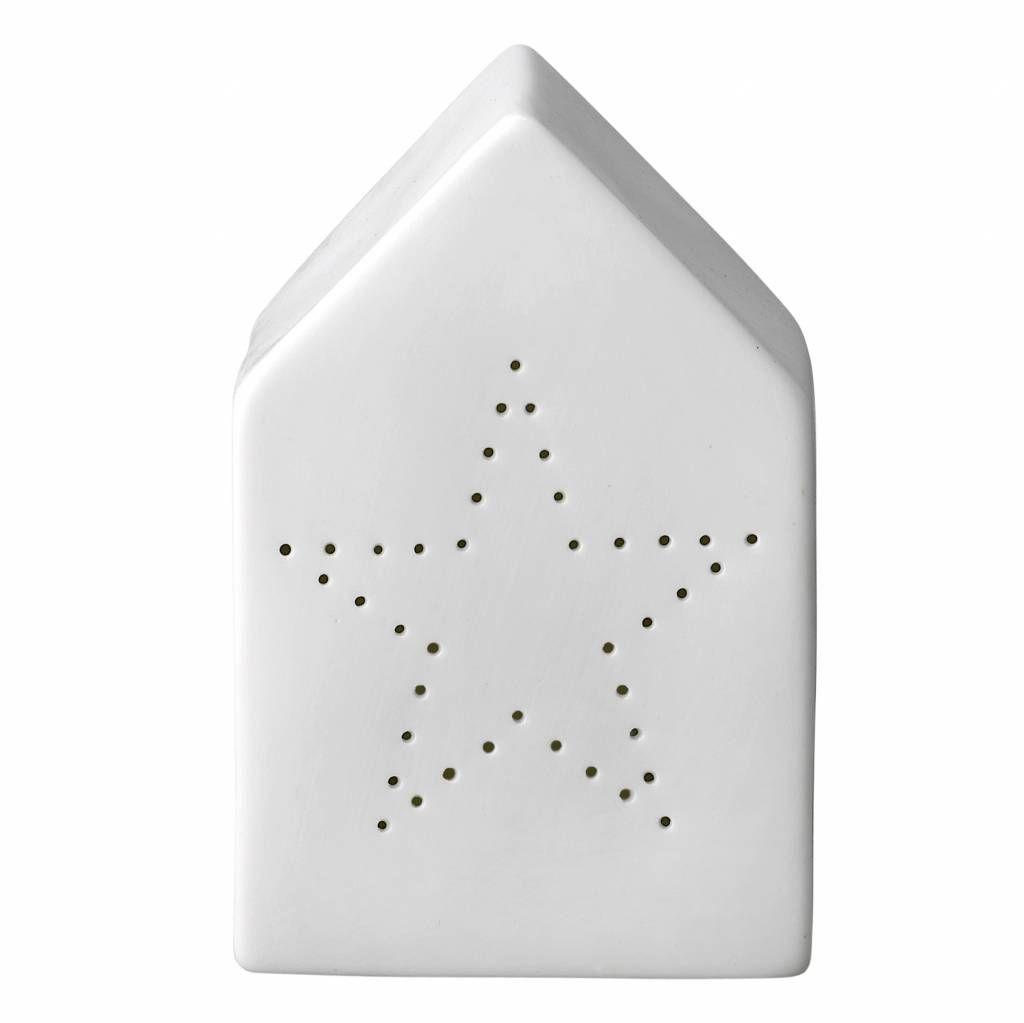 Schattig wit huisje met gaatjes in de vorm van een ster van wit porselein. In…